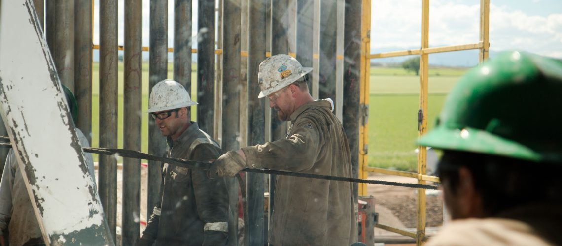 Rig worker drilling for oil